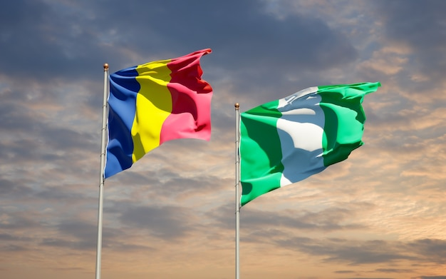 Beautiful national state flags of nigeria and chad together on blue sky