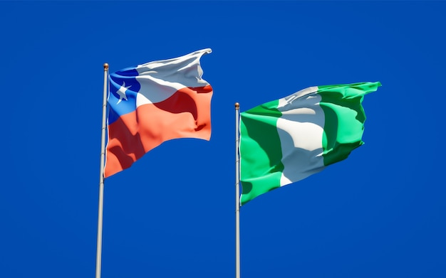 Beautiful national state flags of nigeria and chile together on blue sky