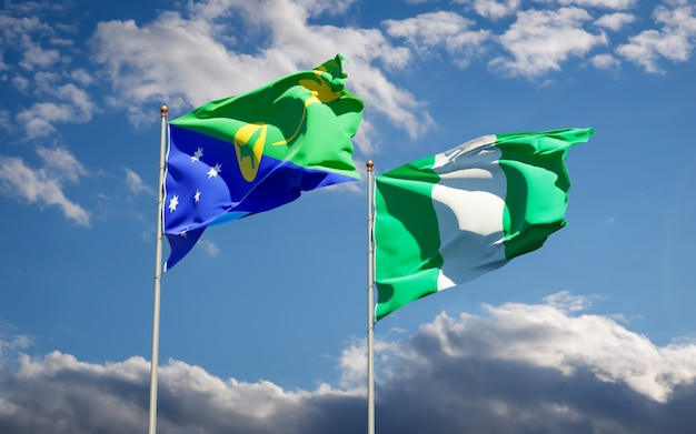 Beautiful national state flags of nigeria and christmas island together on blue sky