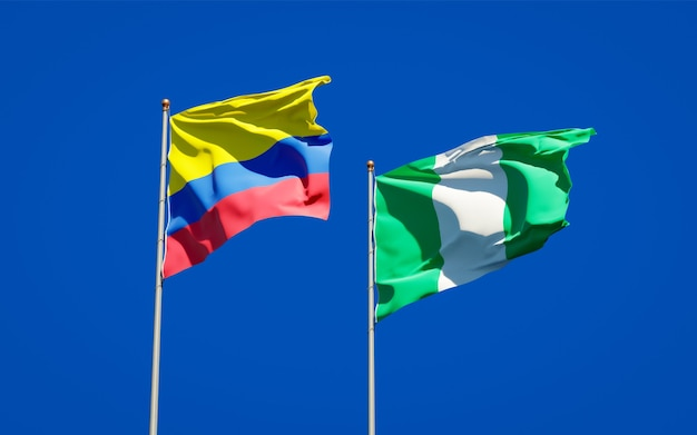 Beautiful national state flags of nigeria and colombia together on blue sky