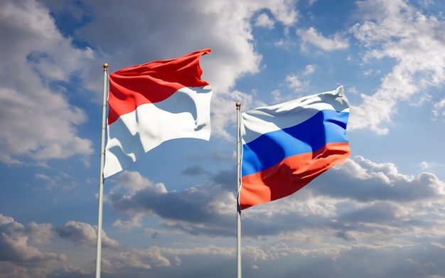 Beautiful national state flags of nigeria and russia together on blue sky. 3d artwork