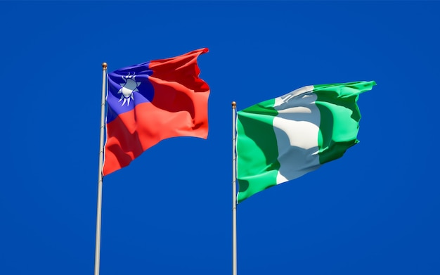 Beautiful national state flags of nigeria and taiwan together on blue sky
