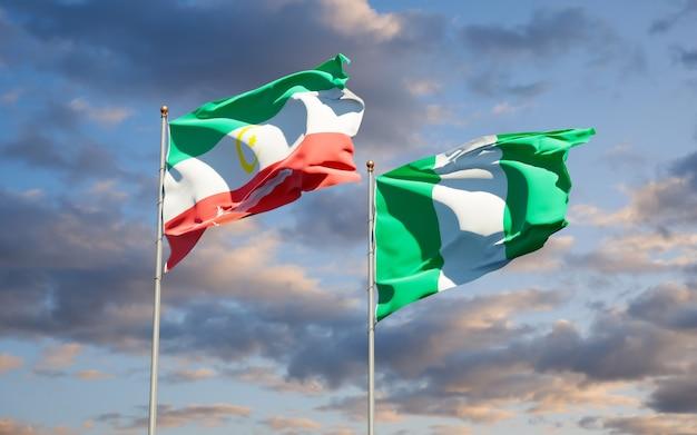 Красивые национальные государственные флаги бангсаморо и нигерии вместе на голубом небе