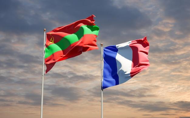 Красивые национальные государственные флаги франции и bb вместе в небе