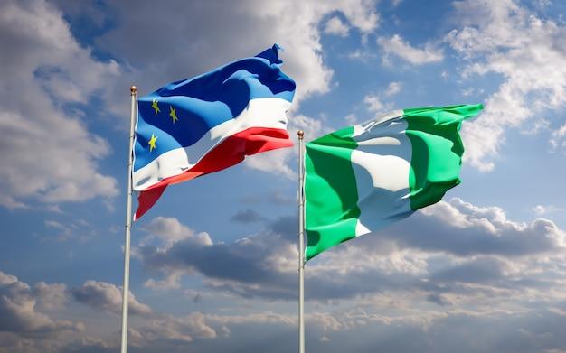 Красивые национальные государственные флаги гагаузии и нигерии вместе на голубом небе