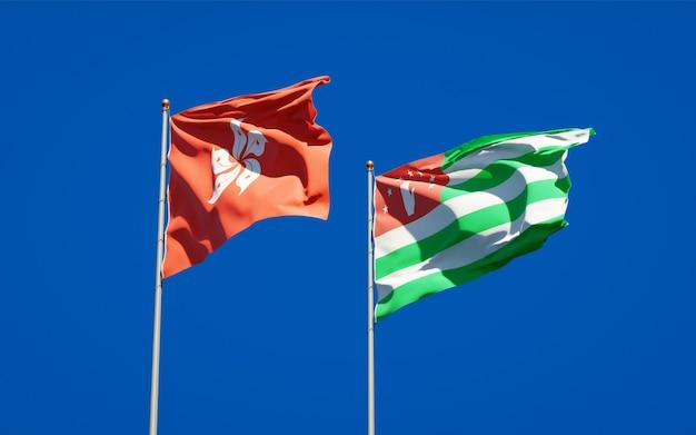 Красивые национальные государственные флаги гонконга, гонконга и абхазии вместе