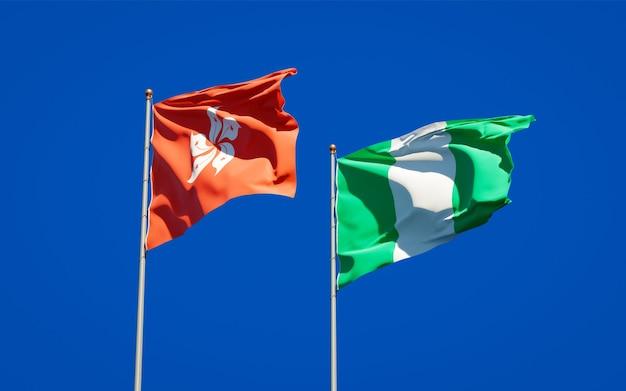 Красивые национальные государственные флаги гонконга, гонконга и нигерии вместе на голубом небе