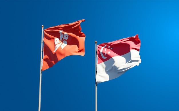 Красивые национальные государственные флаги гонконга, гонконга и сингапура вместе
