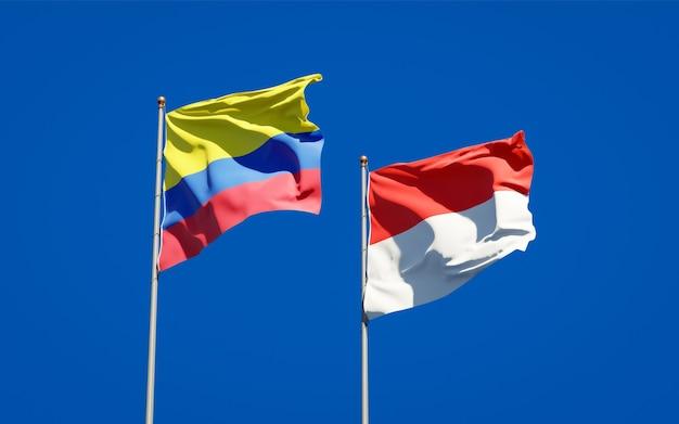 Красивые национальные государственные флаги индонезии и колумбии вместе на голубом небе