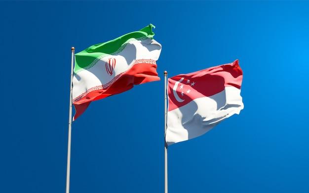 Красивые национальные государственные флаги ирана и сингапура вместе