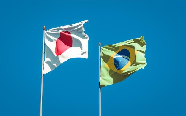 Красивые национальные государственные флаги японии и бразилии вместе на голубом небе