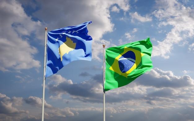 Красивые национальные государственные флаги косово и бразилии вместе на голубом небе