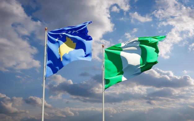 Красивые национальные государственные флаги косово и нигерии вместе на голубом небе
