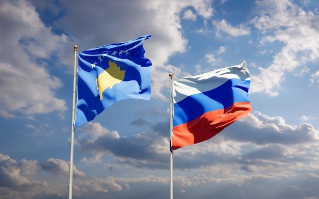 Красивые национальные государственные флаги косово и россии вместе на голубом небе. 3d изображение