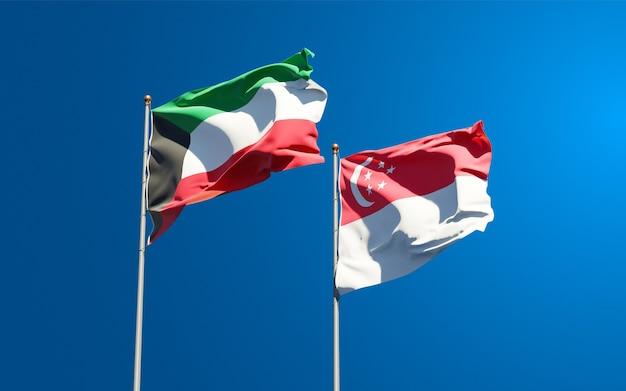 Красивые национальные государственные флаги кувейта и сингапура вместе