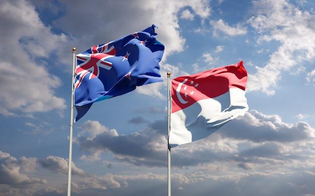 Красивые национальные государственные флаги новой зеландии и сингапура вместе
