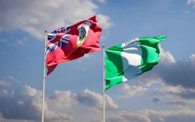 Красивые национальные государственные флаги нигерии и бермудских островов вместе на голубом небе