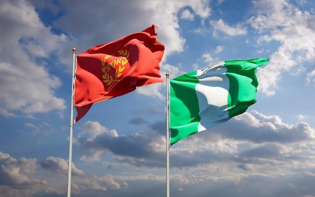 Красивые национальные государственные флаги новой ромы и нигерии вместе на голубом небе