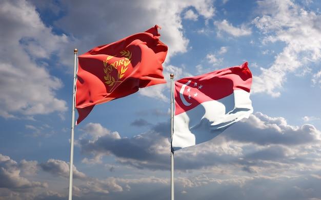 Красивые национальные государственные флаги новой ромы и сингапура вместе