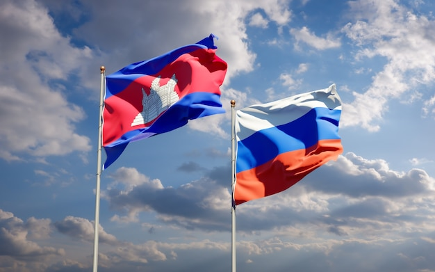 Красивые национальные государственные флаги россии и камбоджи вместе на голубом небе. 3d изображение