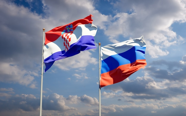 Красивые национальные государственные флаги россии и хорватии вместе на голубом небе. 3d изображение