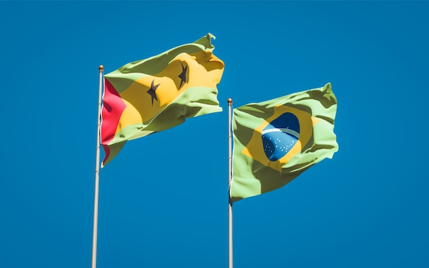 Красивые национальные государственные флаги сан-томе и принсипи и бразилии вместе на голубом небе