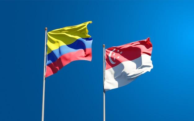 Красивые национальные государственные флаги сингапура и колумбии