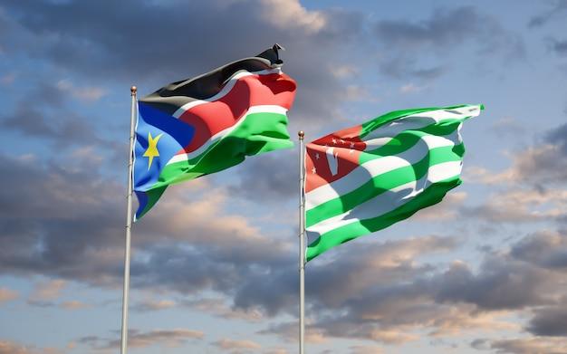 Красивые национальные государственные флаги южного судана и абхазии вместе