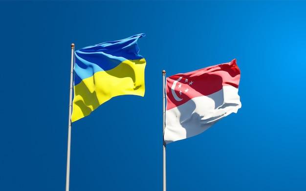 Красивые национальные государственные флаги украины и сингапура вместе