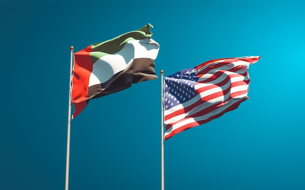 Красивые национальные государственные флаги объединенных арабских эмиратов, оаэ и сша вместе