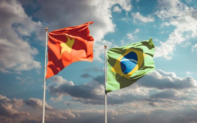 Красивые национальные государственные флаги вьетнама и бразилии вместе на голубом небе
