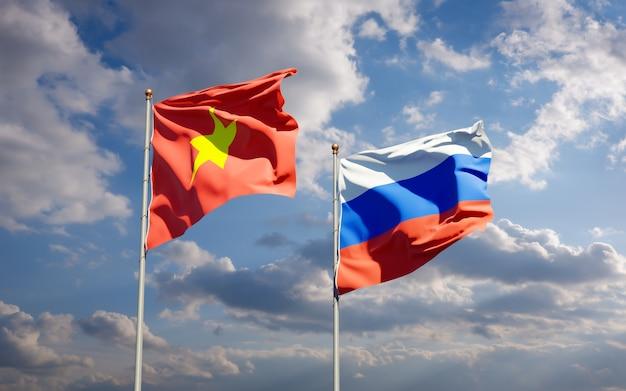 Красивые национальные государственные флаги вьетнама и россии вместе на голубом небе. 3d изображение