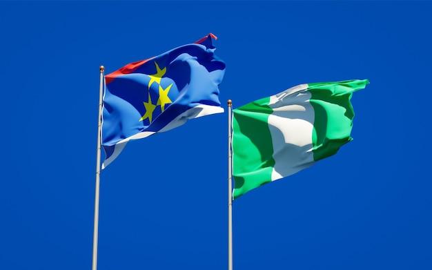 Красивые национальные государственные флаги воеводины и нигерии вместе на голубом небе