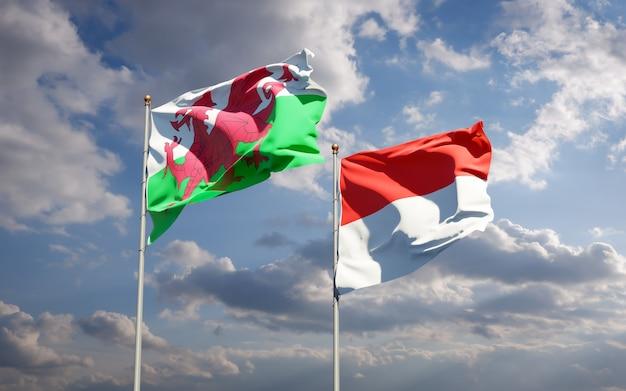 青い空に一緒にウェールズとインドネシアの美しい国の旗