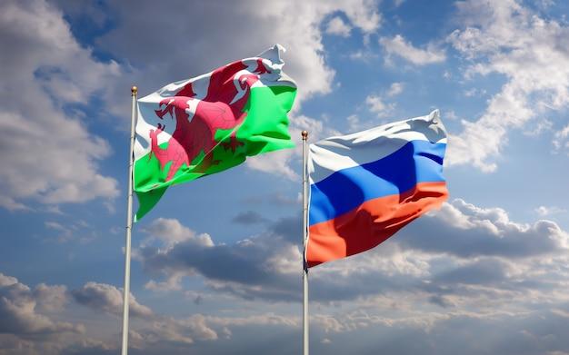 青い空に一緒にウェールズとロシアの美しい国の旗。 3dアートワーク