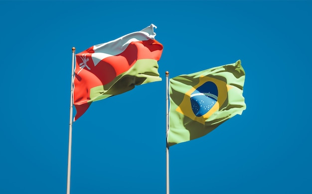 Beautiful national state flags of oman and brasil together on blue sky