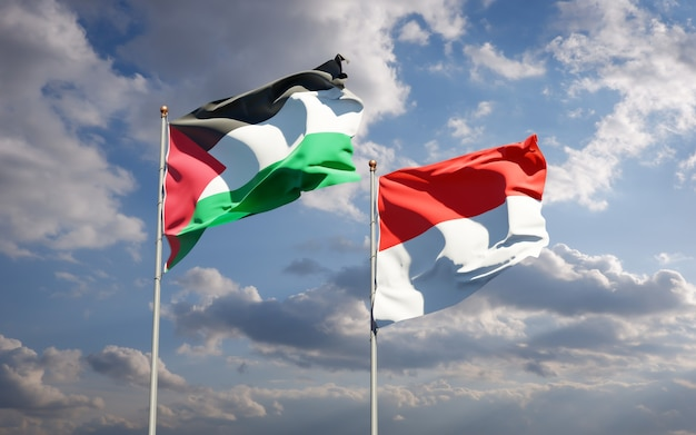 Beautiful national state flags of palestine and indonesia together on blue sky