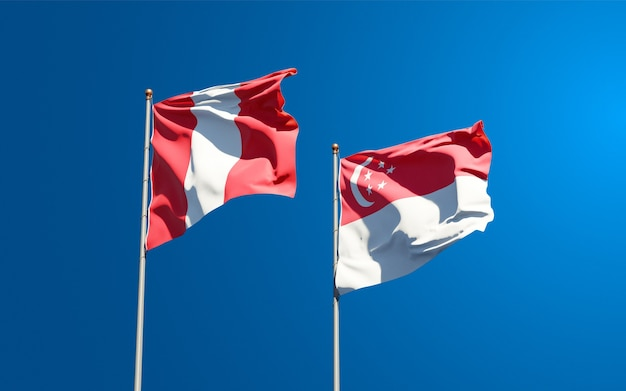Beautiful national state flags of peru and singapore together