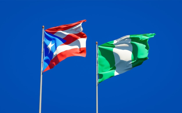 Beautiful national state flags of puerto rico and nigeria together on blue sky
