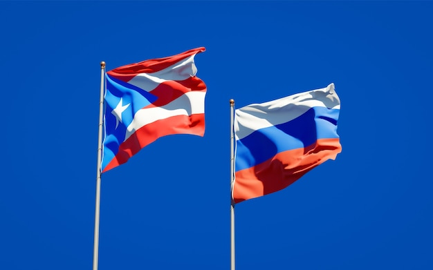 Beautiful national state flags of puerto rico and russia together on blue sky. 3d artwork