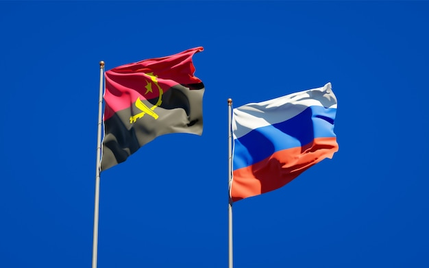 Beautiful national state flags of russia and angola together on blue sky. 3d artwork