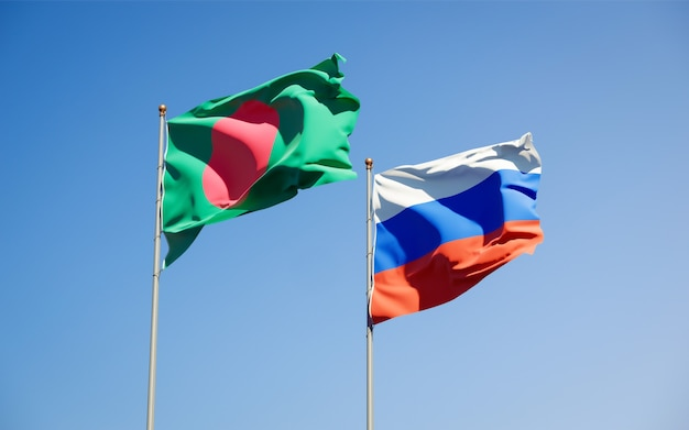 Beautiful national state flags of russia and bangladesh together on blue sky. 3d artwork