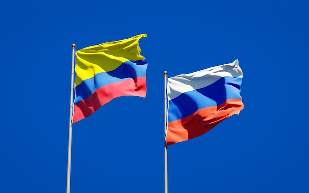 Beautiful national state flags of russia and colombia together on blue sky. 3d artwork
