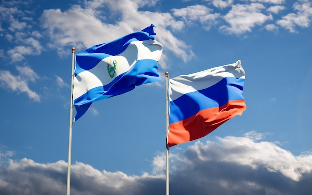 Beautiful national state flags of russia and el salvador together on blue sky. 3d artwork