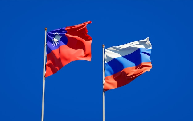 Beautiful national state flags of russia and taiwan together on blue sky. 3d artwork