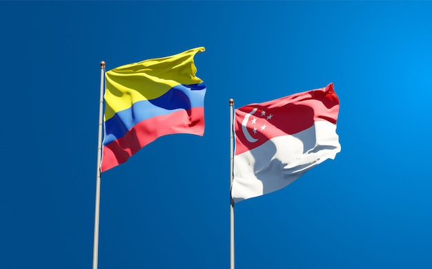 Beautiful national state flags of singapore and colombia