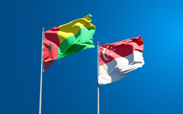Beautiful national state flags of singapore and guinea bissau