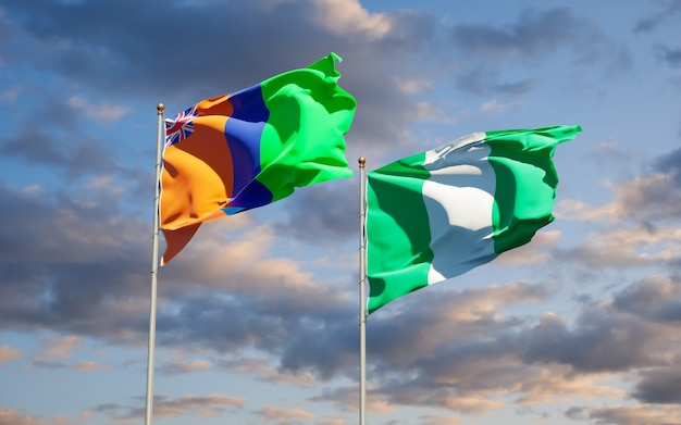 Beautiful national state flags of sultanate of m'simbati and nigeria together on blue sky