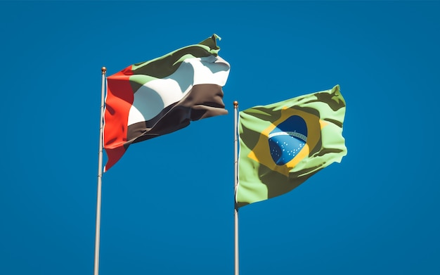 Beautiful national state flags of united arab emirates uae and brasil together on blue sky