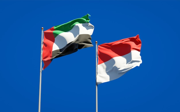 Beautiful national state flags of united arab emirates uae and indonesia together on blue sky